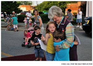 Children hug Gray-Haired Granny